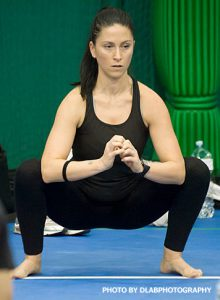 Laura Callegari conducting a  squat